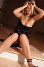 Tasty blonde in black lingerie is smoking sexy