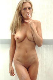 Busty blonde smoker with sexy perfect body