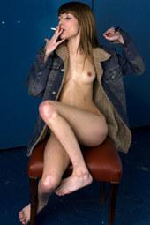Petite young smoking hottie wearing a denim jacket