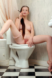 Sexy body young fairy is smoking sitting on the toilet