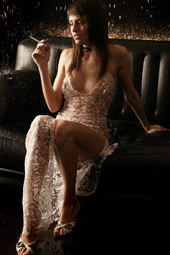 Sexy girl in see-through wet dress is the smoker too