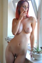 Sweet busty nude smoking sexy redhead